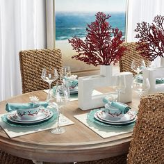 Since I have these chairs and a similar table......why not Set the stage for a stylish summer Sunday brunch with a sea-inspired look.