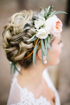 Braided bun with a flower crown. Photography: bellamintphotography.com