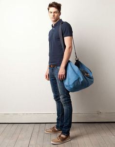 Shop this look on Lookastic:  https://lookastic.com/men/looks/polo-skinny-jeans-boat-shoes-duffle-bag-belt/10111  — Charcoal Polo  — Tan Leather Belt  — Blue Canvas Duffle Bag  — Navy Ripped Skinny Jeans  — Tan Suede Boat Shoes