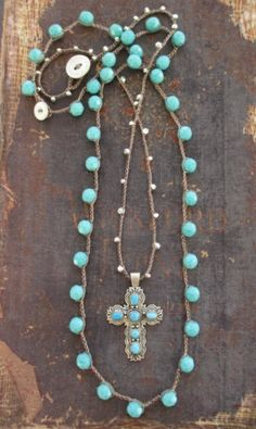Fine silver beads are crocheted to hold a vintage turquoise and sterling cross pendant. Layered, and included, is a czech glass crocheted necklace to wear alone or together! Cross necklace measures 19 long. Loop closure with an etched mother of pearl button. Glass necklace measures 27
