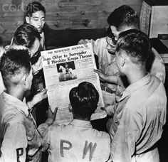 Original caption:Sept.1945-Camp McCoy, WIS.: Japanese prisoners of war read newspaper announcing impending surrender of Japan. This is first photo showing Japanese PW's in American Prisoner of War camps ever released.