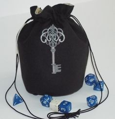 Black dice pouch with a skeleton key design.