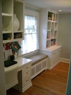 Window seat flanked by desk and bookcase.