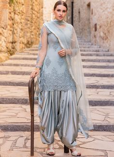 Dusty Blue Grey Embroidered Punjabi Suit features a net kameez with santoon inner, net + santoon bottom and net dupatta.