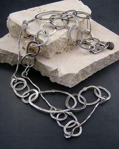 Eccentric Links, hand-formed sterling silver links; kathy van kleeck