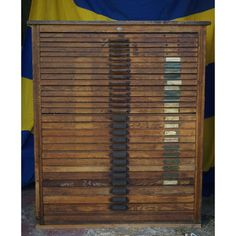 Antique letterpress cabinet with 28 drawers, and the drawers have little dividers in them.  A bead hoarder's dream storage.