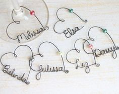 Wire Name Wine Glass Charms - very generic tutorial, but pretty self explanatory. Find a pretty script font and bend and shape wire to create name. Add bead or charm and leave enough wire on each end to  create a clasp. Makes nice personalized favors.