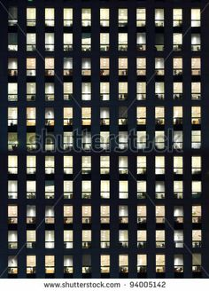 Office Building Exterior In The Late Evening With Interior Lights On