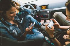 Woman using her cellphone in the car while taking a break