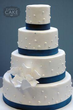Jessica & Brad's Wedding Cake Simple elegance with a stunning sugar paste blossom. - http://apieceocake.com/gallery/album/wedding/page8#