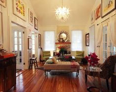 """""""The living room is very romantic and houses the most colorful and playful art, antiques, and chandeliers."""""""