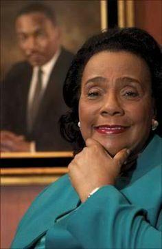Mrs. Coretta Scott King.... Portrait Of Dr. Martin Luther King In Background...