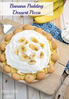 A homemade vanilla wafer pizza crust is topped with a banana pudding frosting, banana chips, fresh whipped cream, and a garnish of vanilla wafers in this Banana Pudding Dessert Pizza. #Happimess #DeltaLiving