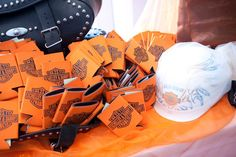 Harley Wedding Favors: These koozies were a hit as wedding favors for our guest. Plus I used my old saddle bags and wrapped my helmet in net.