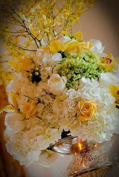 WOW! Wedding table centerpiece created by the Florentine Flower and Gift Shoppe for a wedding at the Aldrich Mansion