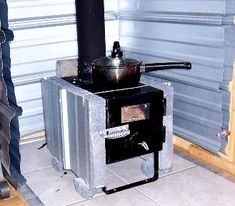Small Cabin Wood Stove Setup - note dual metal wall shield with air space.
