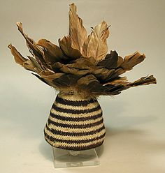Feathered Cap    Geography:      Peru  Culture:      Peru  Medium:      Camelid hair, feathers