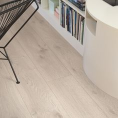Modern Grey Oak is a modern laminate floor featuring long, 2m planks. The feeling of wooden planks is further enhanced by bevels along all four edges. This floor features our Genuine™ wood texture, a lightly polished structure that follows the wood grain in every detail, complemented by a silk matt finish. Our livingExpression quality level is suitable for all-round domestic use. Pergo Laminate, Laminate Flooring, Steel Cutter, Stair Nosing, Grey Oak, Wood Texture, Concrete Floors, Wood Grain, Tile Floor