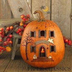 Halloween House - my style.  I'm not into this horrid scary stuff.  I prefer the harvest festival, pre christianity thing