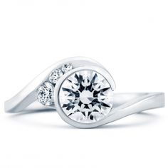Escape Engagement Ring  Style Number 15182 by Mark Schneider - I adore this ring. I don't know what it is about the style, the asymmetry is unique, and it's simple enough that the middle stone stands out. I am not crazy about the accompanying wedding band though