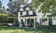 Traditional white home with contrasting trim around wndows