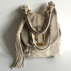 G.I.L.I. Got it. Love it. Handbag pristine!! In pristine condition! I lost the clasp strap that turns in into a backpack so I just make the one strap longer and wear it as a cross body. Gorgeous, textured snakeskin print leather. Interior is in great condition too. Anthropologie Bags