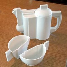 Kasimir Malevich : Constructivist teapot and cups...my absolute dream set.