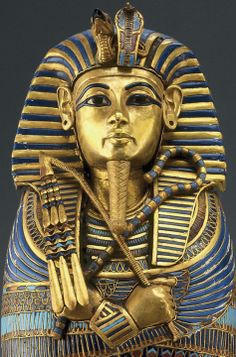 Caponic coffinette of Tutankhamen,iconic headress called Nemes style. the egyptian sphinx in gaza is believed to wear one.