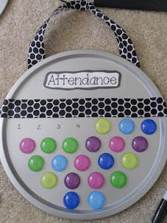 DIY attendance idea using a pizza pan and magnets--could ask the students to bring a wallet size picture of themself, mod podge it onto a wooden square and then hot glue a magnet to the back. They check themselves in at the beginning of the day. Classroom Setup, Future Classroom, Reggio Classroom, Classroom Environment, Kindergarten Classroom, Attendance Chart, Attendance Ideas, Teacher Boards, Teacher Sites