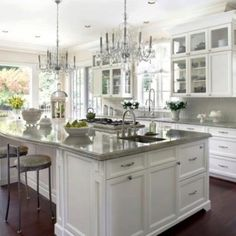 I love the idea of chandeliers in the kitchen. This is my white dream kitchen!