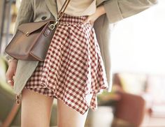 Cute outfit with the red plaid skirt, light green jacket and the brown envelope crossbody purse.
