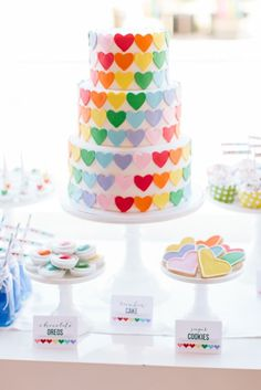 rainbow heart cake with rainbow layers inside! http://www.thetomkatstudio.com/rainbowheartparty