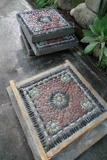 DIY MOSAIC STEPPING STONES.  This website has lots of good tips for making stepping stones so they don't break over time.