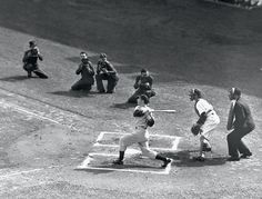 Joe DiMaggio singles in the first inning of a 1938 game against the Senators. Photographers are crouched along the first base line, which was legal back then as long as they remained in foul territory. Baseball Jerseys, Baseball Players, Baseball Uniforms, Football, America's Pastime, Baseball Training, Baseball Pictures, Joe Dimaggio, Summer Games