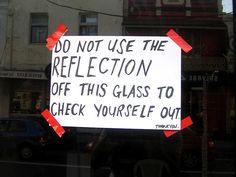 An amusing sign in a shop window in Glebe
