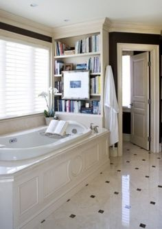 A bookshelf over the bathtub?  The perfect remedy to those times when I've sunk into a perfect, hot bath and then realized I left my book all the way downstairs.  (Now where I can put the wine fridge in the bathroom, for the same reason?)
