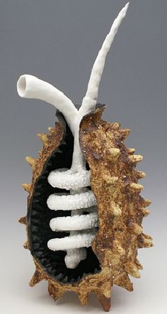 "One Lifetime, 2008 Ceramic Sculpture: paperclay, ""Grogzilla"" sculpture clay, Black Mountain sculpture clay, Southern Ice Porcelain paperclay. Iron oxide, Cobalt oxide, Beaded White glaze - High fire 24""H x 11""W x 8""D"