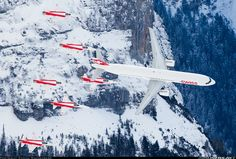 Swiss International Airlines Airbus A321-111 preforming with Patrouille Suisse Air Force F-5F Tigers