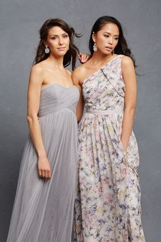 """Strapless """"Felicity"""" bridesmaid dress in grey and """"Chloe"""" one-shoulder floral bridesmaid dress. #BridesmaidDresses Photography: Courtesy of Donna Morgan. Read More: http://www.insideweddings.com/news/fashion/glitzy-bridesmaid-dresses-your-girls-will-want-to-wear-again/1998/"""
