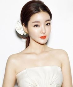 asian makeup with bold orangey red lip