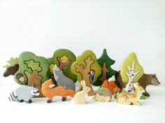 This big set includes Forest animals set (9 pcs) and tree set (5 pcs).  Forest animals: Elk, Bear, Wolf, Fox, Racoon, Reindeer, Squirrel, Hare, Hedgehog  Trees: Oak tree, Oak tree & an owl, Tree & a bird, Fir tree, Birch tree.  This set would be a great addition to any waldorf nature table or play space.  These toys will help you child to develop his imagination, to learn names of the animals, colors etc.  It is 100% handmade. Great colors, original design!  SIZE: Animals: 1. Bear - ...