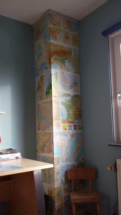 De hele wereld op de muur met een atlas uit de kringloopwinkel