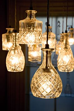 Lee Broom's decanterlights. These are made from lead crystal but I bet they'd be pretty (and DIYable) with vintage pressed glass decanters. And maybe a splash of looking-glass paint.