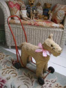 sweet little vintage dog on wheels