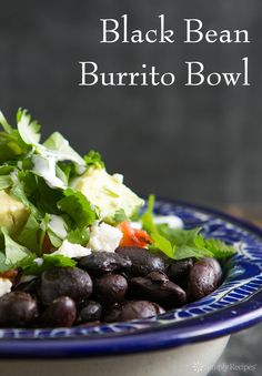 Burrito Bowl! With black beans, rice, avocados, salsa, red cabbage, and lime. So EASY and delicious! #vegetarian #recipe SimplyRecipes.com
