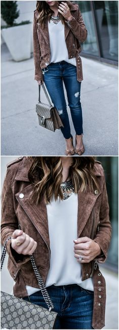 Tiffany Jais a Houston Style blogger is wearing a suede moto jacket by Blank NYC and Staggered hem jeans from Nordstrom, along with her favorite Gucci Dionysus bag  