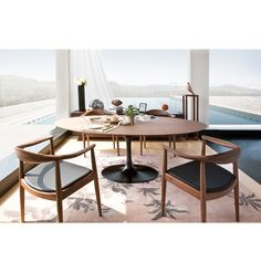 Iconic Saarinen Table for Interior Design with Relaxed Impression: Contemporary Area Rug And Modern Dining Chairs With Saarinen Table Also Glass Walls With Curtain And Eero Saarinen Table Plus Cabinet With Wood Flooring And Knoll Tulip Table For Dining Room
