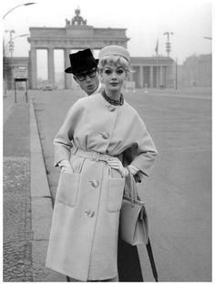 Ina Balke in coat by Gehringer & Glupp in front of Brandenburg Gate, Berlin, photographed for Beyer Moden, Spring:Summer 1960