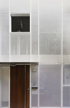 KC Design Studio has updated a house in Taiwan with a perforated facade and light-well to combat poor daylighting Facade Design, Wall Design, Exterior Design, Metal Facade, Expanded Metal, Space Interiors, Building Facade, Facade Architecture, Futuristic Architecture