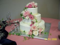 Pink and white #roses and #ranunculus #wedding cake #flowers trailing down 3 layers